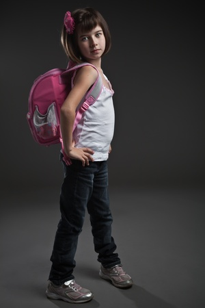 innocent girl: Portrait of a cute small girl going to school Stock Photo