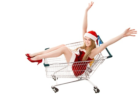 Christmas woman in santa hat sitting in shopping cart over white background  photo