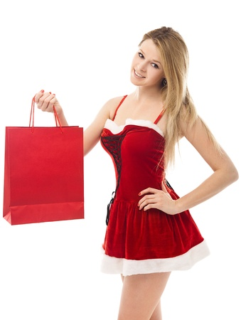 Portrait of a Christmas woman in santa hat holding a shopping bags over white background  photo