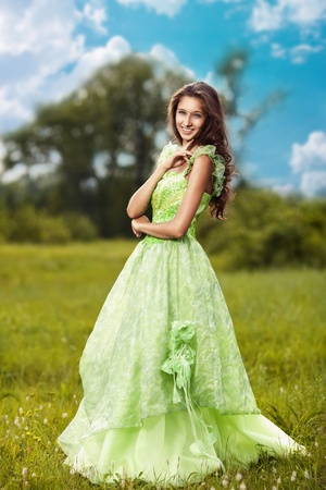 Portrait of a young beautiful woman on the nature  photo