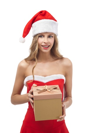 Happy Christmas woman holding gift wearing Santa costume  Stock Photo - 11590862
