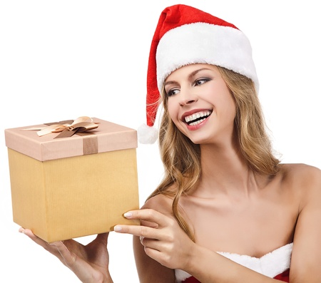 Happy Christmas woman holding gift wearing Santa costume  Stock Photo - 11590874