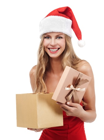 Happy Christmas woman holding gift wearing Santa costume  Stock Photo - 11590860