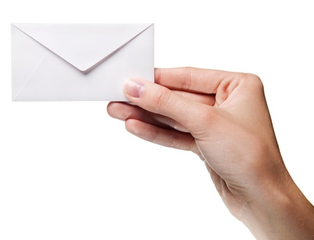 grasp: womans hand holding closed envelope isolated