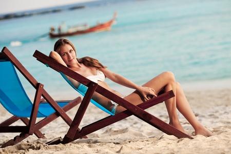 Beautiful woman in lounge on the beach. Phi phi island. Thailand  photo