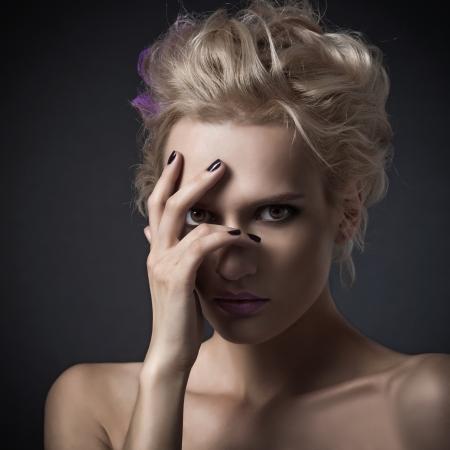 Fashion woman portrait on dark background