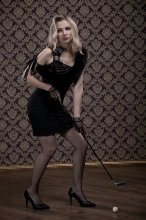 sexy legs stockings: Seductive retro woman with golf club