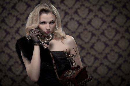 Blond woman talking on the phone. Retro portrait  photo