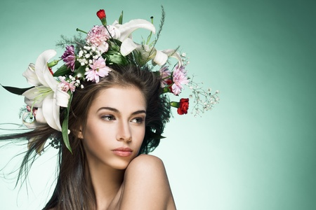 beautiful long hair: Beautiful woman with flower wreath. Space for text. Stock Photo