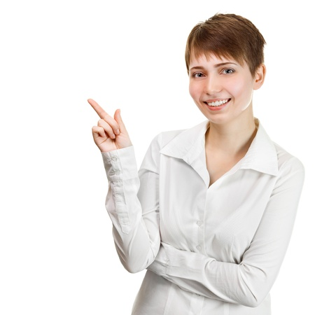 Closeup portrait of a happy young business woman pointing at something interesting against white background  photo