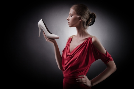 Beautiful woman in red dress. Girl and shoe  photo