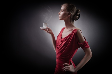 Elegant woman with an aromatic coffee in hands  photo