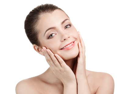 touching face: portrait of a happy beautiful smiling woman, isolated against white background