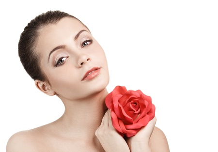 ageing: Portrait of young beautiful woman with red rose