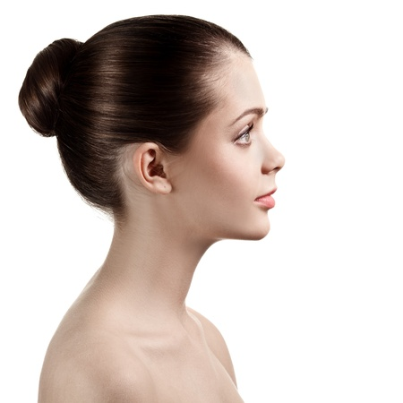 Portrait of profile charming woman with bared shoulders, on white background. Stock Photo - 12638349