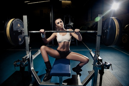 Sporty sexy woman in gym