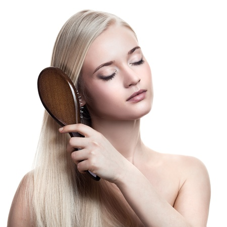 portrait of a beautiful young blonde woman comb wonderful hair  Stock Photo - 12638743