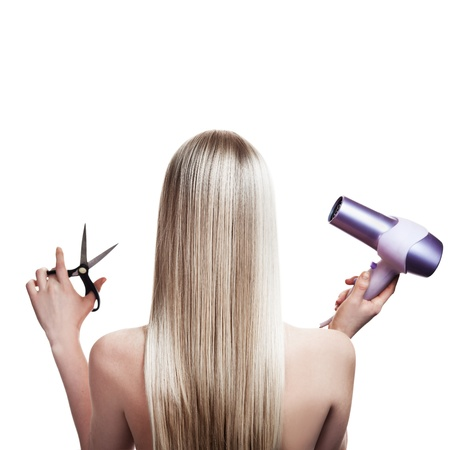 haircutting: Blonde hair and hairdressers tools