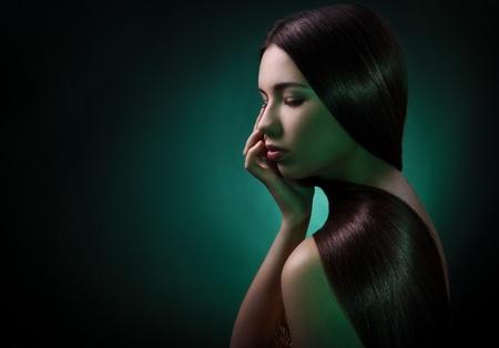 Fashion portrait of a brunette woman. Healthy Long Hair  Stock Photo