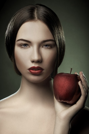 Portrait of caucasian young woman with apple photo