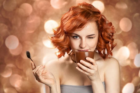 young pretty woman drinking coffee  photo