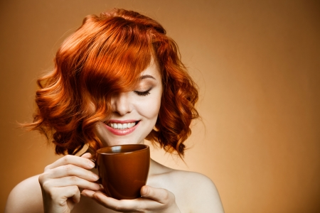 Stylish woman with an aromatic coffee in hands  photo