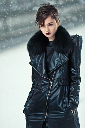Stylish brunette woman in leather coat photo