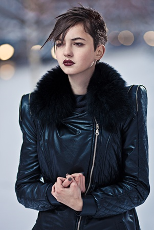 Stylish brunette woman in black coat  photo