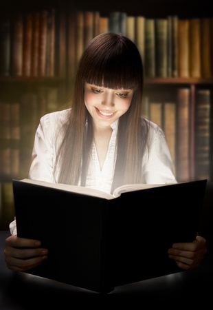 Teen girl reading the Book. Education  photo