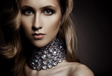 Beautiful woman with evening make-up. Jewelry and Beauty. Fashion photo  photo