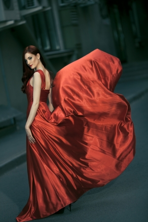Sexy young beauty woman in fluttering red dress Stock Photo - 14030742