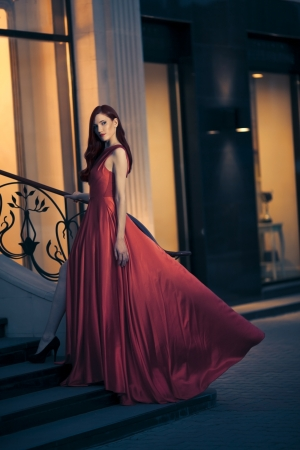 wind dress: Sexy young beauty woman in fluttering red dress Stock Photo