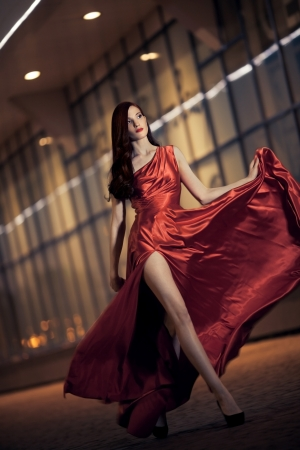 girl in red dress: Sexy young beauty woman in fluttering red dress Stock Photo
