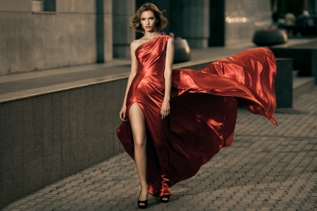 Sexy young beauty woman in fluttering red dress Stock Photo