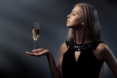 Woman with wine glass in hand photo