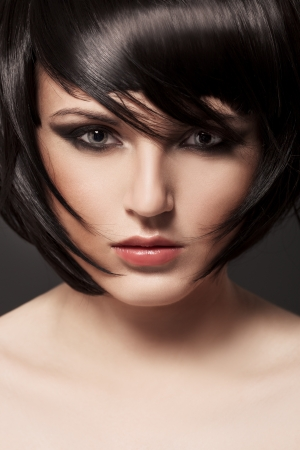 Beautiful Brunette Girl.Healthy Hair.Hairstyle.  photo