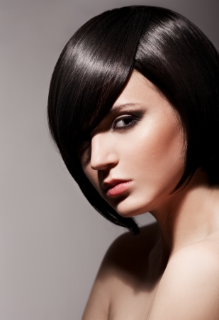 Beautiful Brunette Girl.Healthy Hair.Hairstyle.  Stock Photo - 14030784