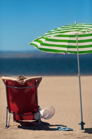 woman lying on a deckchair at the beach Stock Photo - 14330778