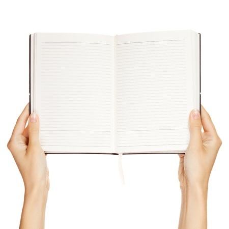 woman hand carrying an empty book isolated on white background  photo