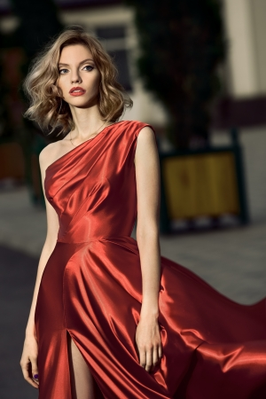 fluttering: Sexy young beauty woman in fluttering red dress Stock Photo