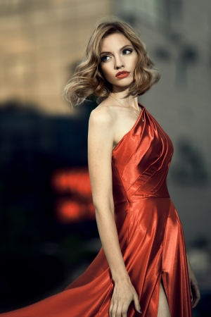 woman red dress: Sexy young beauty woman in fluttering red dress Stock Photo