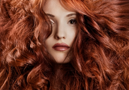 Beautiful redhair woman close-up portrait  photo