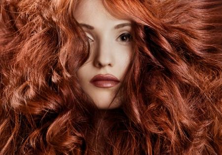 Beautiful redhair woman close-up portrait  photo