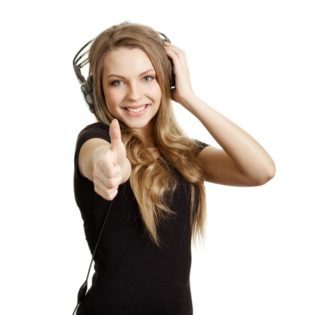 attractive smiling woman with headphones on white background  photo