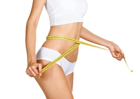 body slim: Femme mesurant son tour de taille. Parfait Slim Body. R�gime Banque d'images