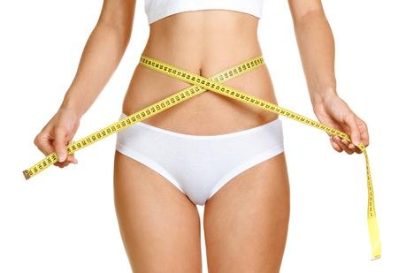 mujer que mide la forma perfecta de muslo hermoso concepto estilos de vida saludable Foto de archivo