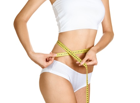 Woman measuring her waistline. Perfect Slim Body. Diet  photo