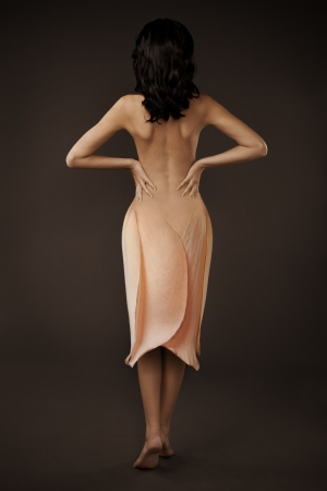 woman nude standing: Elegant Beautiful Woman In A Flower Dress On Dark Background
