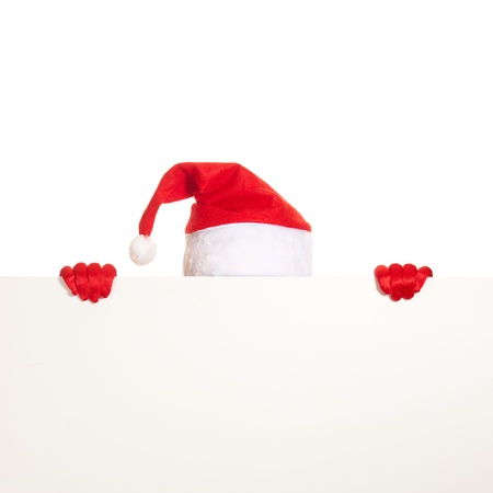 santa cap: santas cap and hands in red gloves hold blank card on white