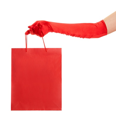 red gloves: Hand in red gloves holding bag isolated over white background